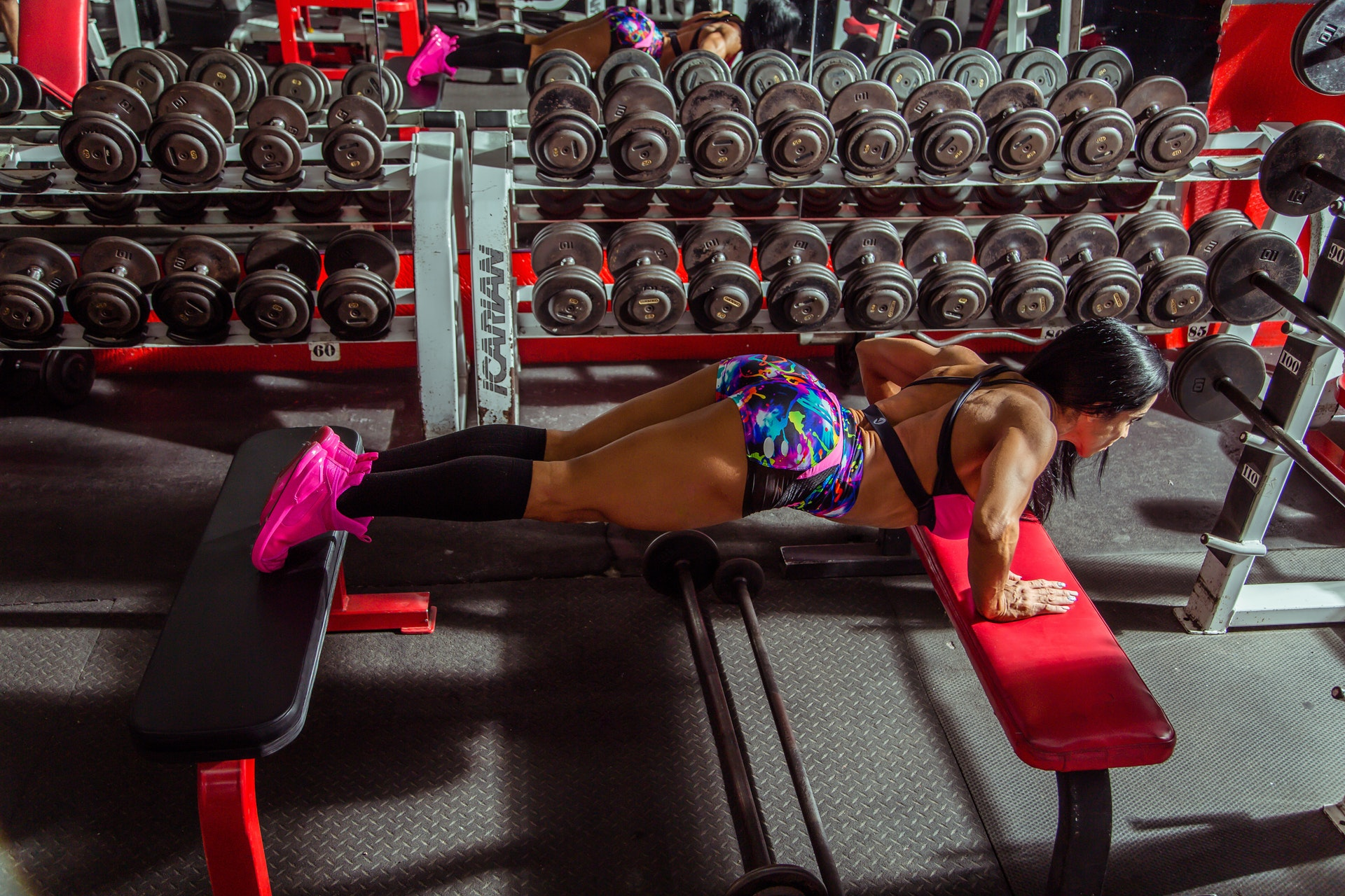 woman-doing-push-ups-on-sit-up-benches-1638336